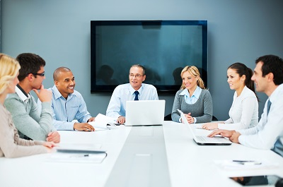 Employees Sitting around a conference table