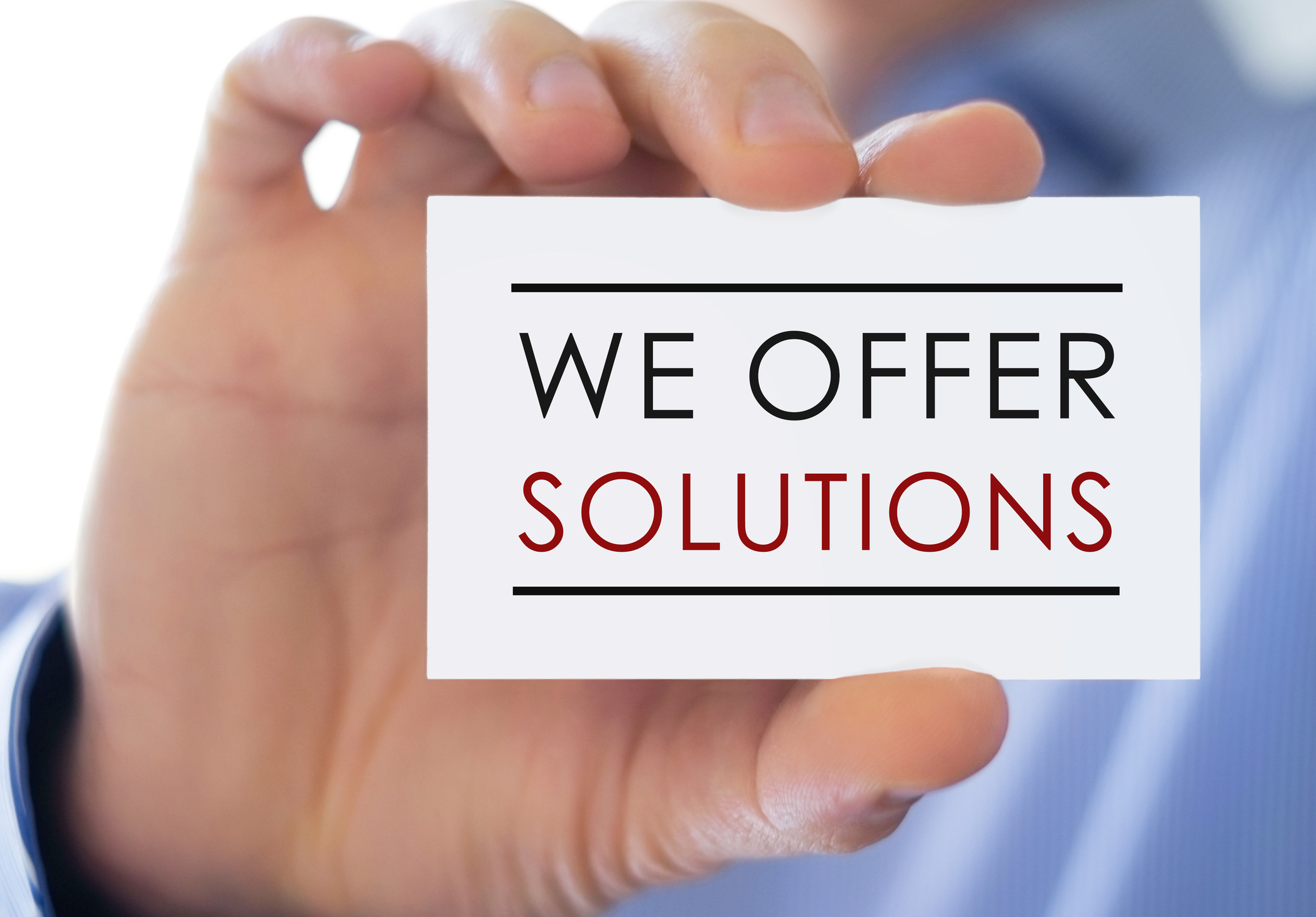 image of man holding we offer solutions card sign